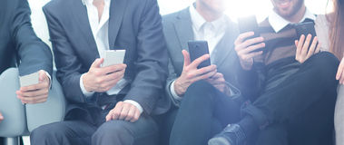 Group of young people use their phones Stock Photo