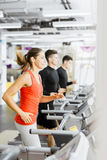 Group of young people using treadmills in a gym Stock Photos
