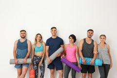 Group of young people waiting for yoga class royalty free stock images