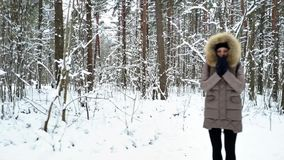 Group of young people is walking along the forest`s trail stock footage