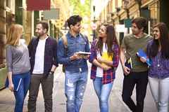 Group of young people walking through the city Stock Photos