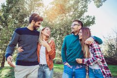 Group of young people walking through park. Stock Photography
