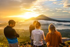Group of young people watch the dawn Royalty Free Stock Photo