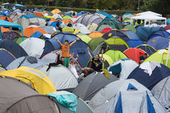 Group of young people waving in Exit campsite Stock Photos