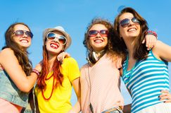 Group of young people wearing sunglasses and hat Royalty Free Stock Photos