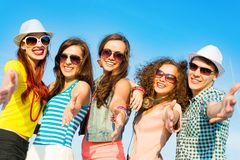 Group of young people wearing sunglasses and hat Royalty Free Stock Image