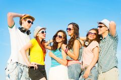 Group of young people wearing sunglasses and hat Stock Photos