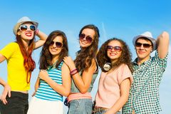 Group of young people wearing sunglasses and hat Royalty Free Stock Images