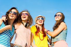 Group of young people wearing sunglasses and hat Stock Image