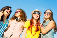 Group of young people wearing sunglasses and hat Royalty Free Stock Photo