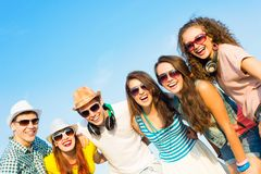 Group of young people wearing sunglasses and hat Royalty Free Stock Photography