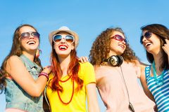 Group of young people wearing sunglasses and hat Stock Photo