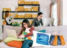 Group of young people work on startup small business at home, online marketing shopping delivery, home business teamwork concept royalty free stock photography