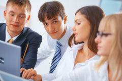 Group of young people working Stock Image