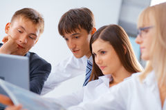 Group of young people working Royalty Free Stock Photos