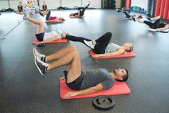Group young people working out in sports club. Group of young people working out in sports club Stock Photography