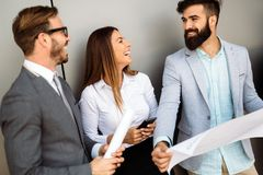 Group of perspective designers discussing in office Royalty Free Stock Photos