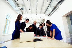 Group of a young prosperous business people in corporate clothes working together in team on joint projects, Stock Photo