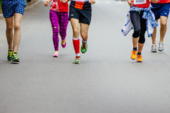 group of young runners running city street royalty free stock image