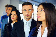Group of a young serious businesspeople Royalty Free Stock Photos