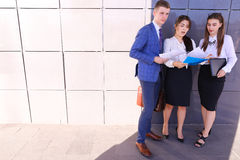 Group of young smart business professionals, students, talking, Royalty Free Stock Image