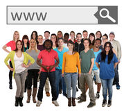 Group of young smiling people searching website online on intern Royalty Free Stock Images