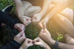 Group of young sport team hands together, team partners giving f stock photos