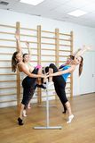 Group of young sports woman does an extension exercise Royalty Free Stock Image