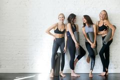 Group of young sporty girls with yoga mats, copyspace stock photos