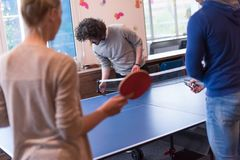 Startup business team playing ping pong tennis Royalty Free Stock Image