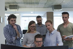 Group of young startup business people standing as team Stock Photo