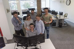 Group of young startup business people standing as team Royalty Free Stock Images