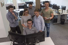 Group of young startup business people standing as team Stock Image