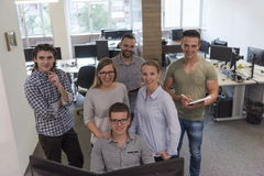 Group of young startup business people standing as team Royalty Free Stock Photos