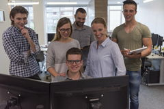 Group of young startup business people standing as team Stock Photos
