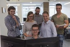 Group of young startup business people standing as team Stock Images
