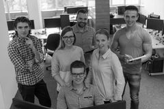 Group of young startup business people standing as team Stock Photography