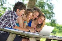 Group of young student using laptop outdoor. Italy Royalty Free Stock Photo