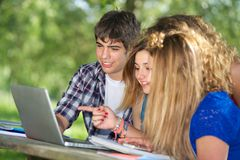 Group of young student using laptop outdoor. Italy Stock Image