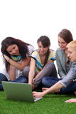 Group of young student using laptop together Stock Photos
