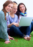 Group of young student using laptop together.  Royalty Free Stock Photos