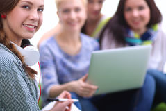 Group of young student using laptop together.  Royalty Free Stock Photo