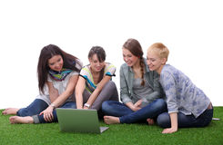 Group of young student using laptop together.  Royalty Free Stock Images
