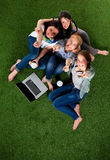 Group of young student using laptop together.  Royalty Free Stock Image