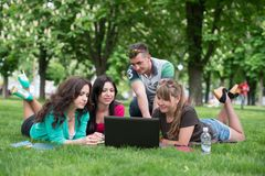 Group of young student using laptop together Royalty Free Stock Images