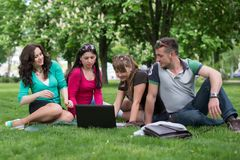 Group of young student using laptop together Royalty Free Stock Photography