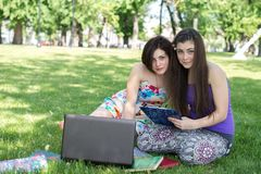 Group of young student using laptop together Stock Images