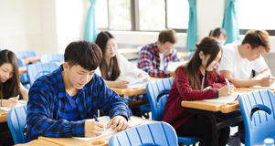 Group of young students  in the classroom Stock Photo