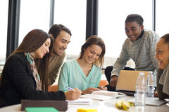 Group of young students studying in the library royalty free stock images