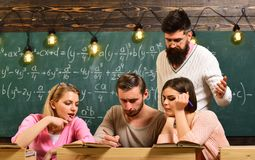 A group of young or students in university reading the book in classroom. Royalty Free Stock Photo